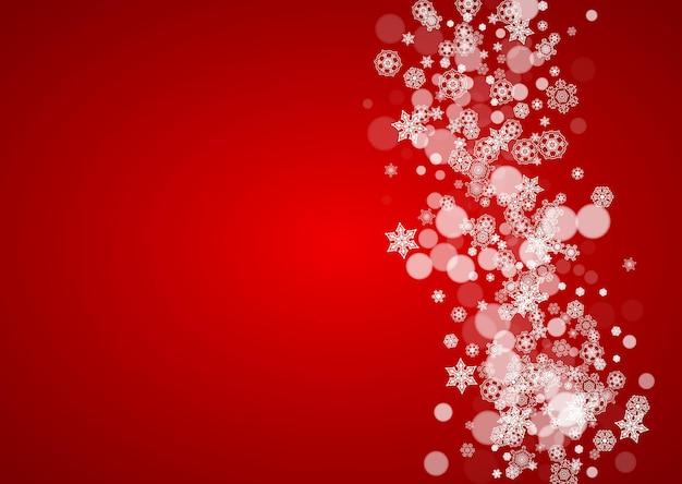 Kerstsneeuw op rode achtergrond. kerstman kleuren. horizontaal frame voor winterbanner, cadeaubon, voucher, advertentie, feestevenement. nieuwjaar en kerstmis sneeuw ontwerp. vallende sneeuwvlokken voor feest