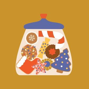Kerstsnoepjes en koekjes in glazen snoeppot