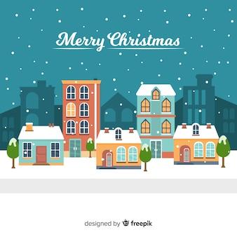 Kerststad achtergrond in platte ontwerp