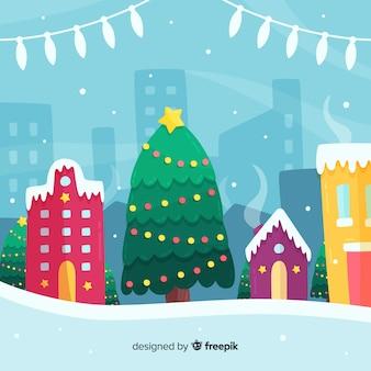 Kerststad met boom in plat ontwerp