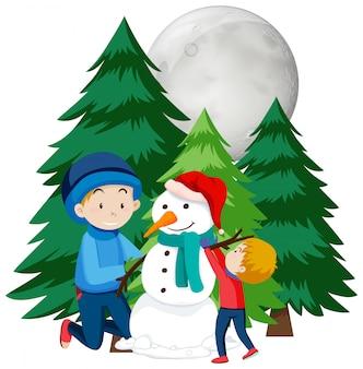 Kerstthema met kinderen manking sneeuwpop