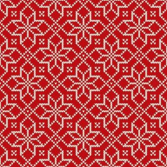 Kerstvakantie gebreid patroon met sneeuwvlokken. breien trui design. naadloze vector achtergrond. Premium Vector