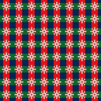 Kerstvakantie gebreide trui patroon ontwerp met chechkered sneeuwvlokken ornament