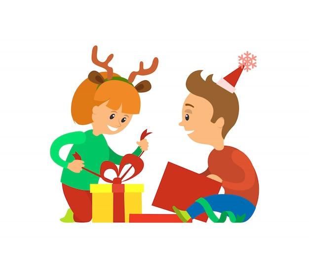 Kerstvakantie, kinderen openen presenteert