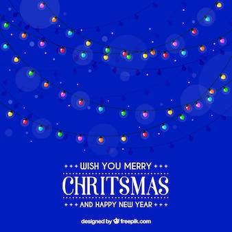 Kerstverlichting op blauwe achtergrond