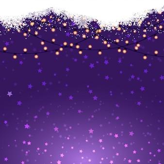Kerstverlichting op een paarse achtergrond