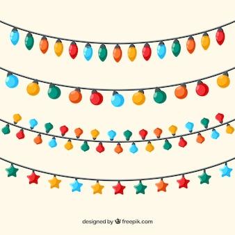 Kerstverlichting van verschillende kleuren Gratis Vector