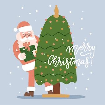 Kerstwenskaart met de kerstman die achter een versierde boom vandaan gluurt met een geschenkdoos in h...