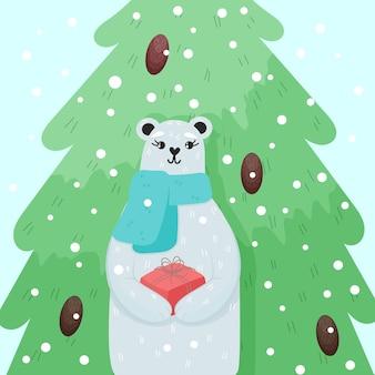 Kerstwenskaart schattige ijsbeer die de huidige doos vasthoudt en voor de boom staat