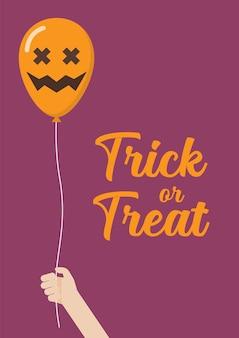 Kid hand met enge lucht ballonnen. trick or treat halloween-poster.