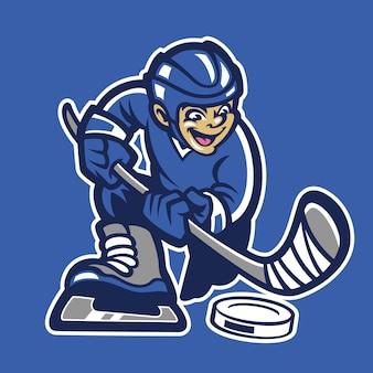 Kid spelen hockey ijs