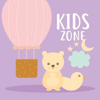 Kids zone belettering en set van schattige pictogrammen op een paarse achtergrond