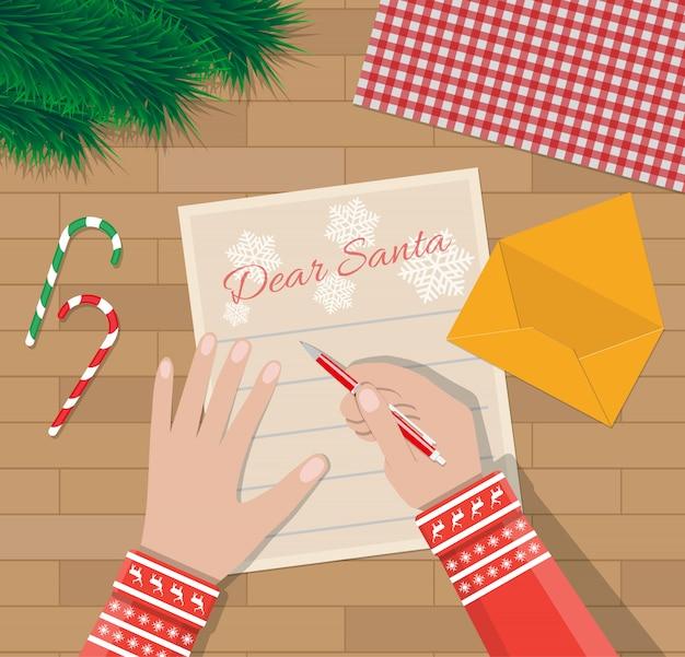 Kind hand met pen brief schrijven aan de kerstman