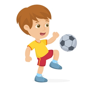 Kind schopt een bal