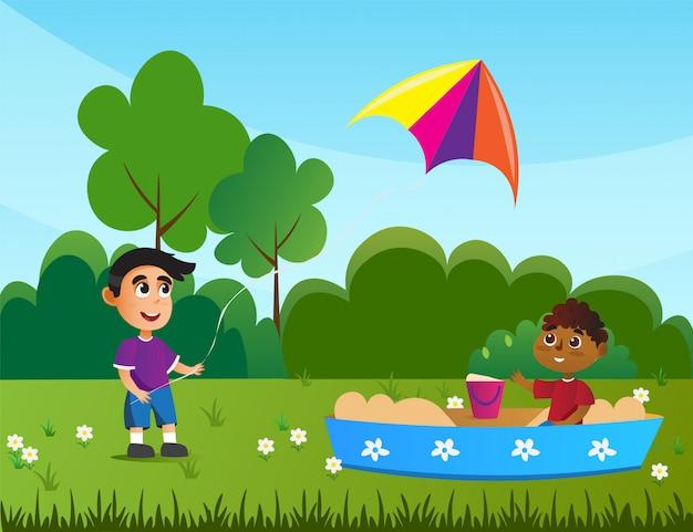 Kind spelen in zandbak, jongen met vliegende vlieger.