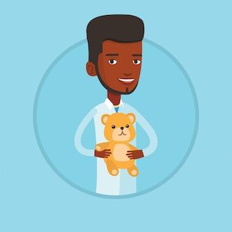 Kinderarts arts teddybeer te houden.