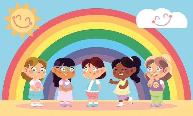 Kinderdag, vrolijke kleine meisjes en regenboogdecoratie