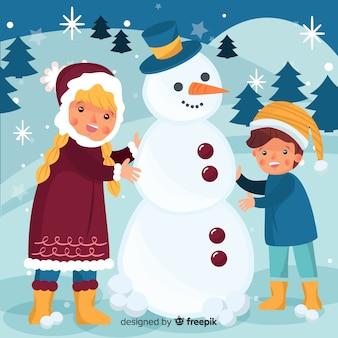 Kinderen bouwen sneeuwpop
