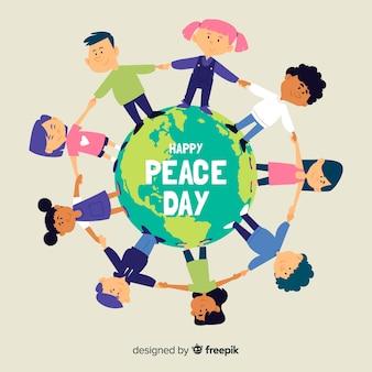 Kinderen die handen op vredesdag houden