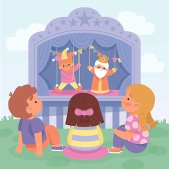 Kinderen kijken samen naar een poppenspel