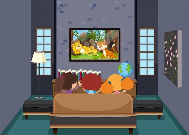 Kinderen kijken tv in de woonkamer