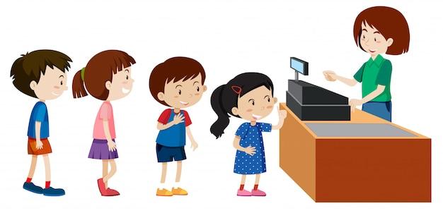 Kinderen kopen bij een kassier