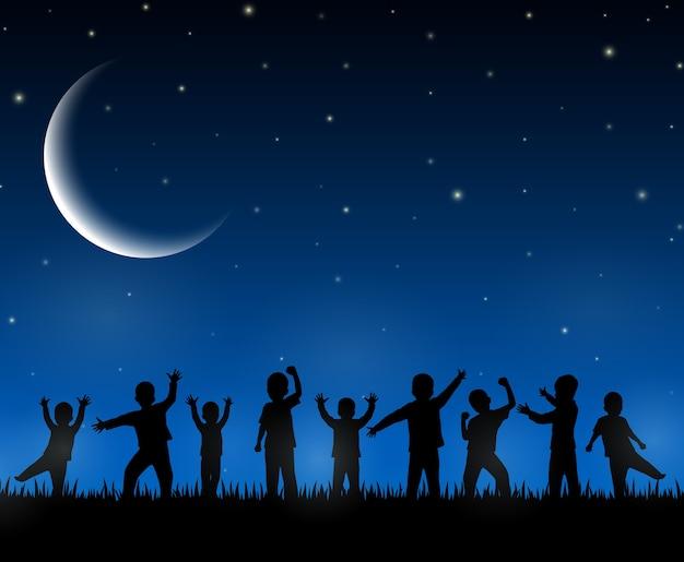 Kinderen silhouet op de nacht achtergrond