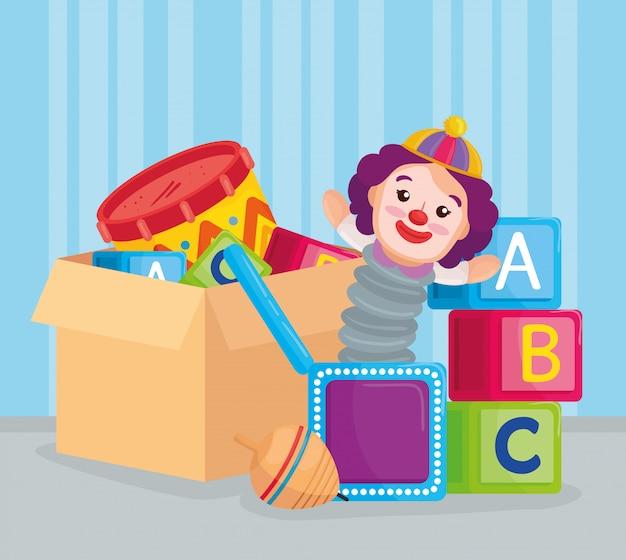 Kinderen speelgoed, blokjes alfabet en speelgoed in kartonnen doos