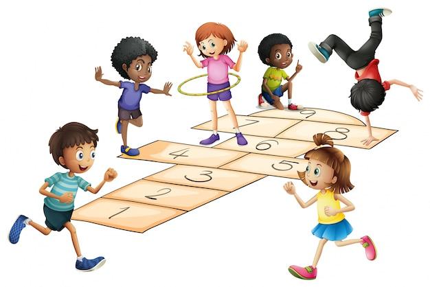 Kinderen spelen hinkelen in het veld