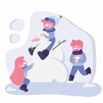 Kinderen spelen in de winter met sneeuw man