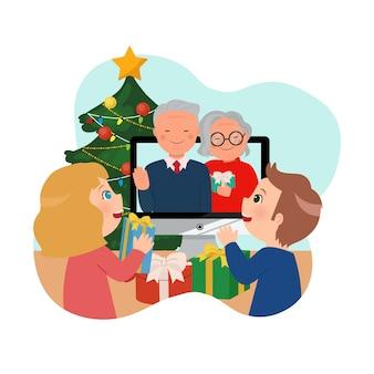 Kinderen vieren kerstmis met hun grootouders via een online videogesprek. blijf veilig thuis tijdens kerst en nieuwjaar.