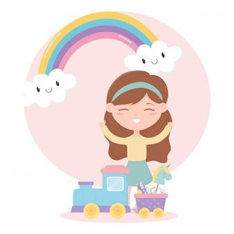 Kinderen zone, schattig klein meisje met speelgoed trein paard stokblokken