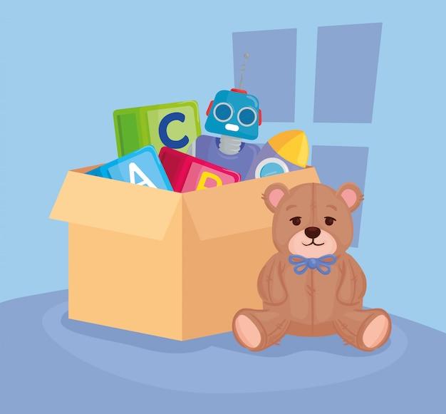 Kinderspeelgoed, teddybeer met speelgoed in kartonnen doos