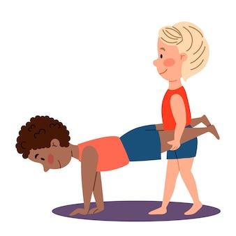 Kindersportgymnastiek een jongen houdt de benen van een ander jongenspaar oefeningen voor de handen