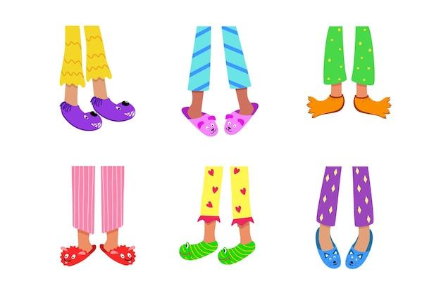Kindervoeten in gekleurde pyjama's en grappige pantoffels. vectorillustratie van thuis slapende kleding en schoenen. het concept van een pyjamafeestje.
