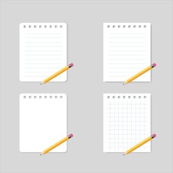 Kladblok en gele houten scherpe potloden