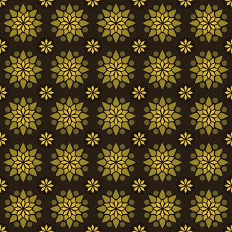 Klassieke batik naadloze patroon achtergrond. luxe geometrisch mandala behang. elegant traditioneel bloemenmotief in geelgouden kleur