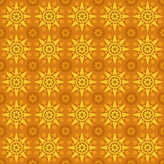 Klassieke batik naadloze patroon achtergrond. luxe geometrisch mandala behang. elegant traditioneel bloemenmotief in oranjegele kleur