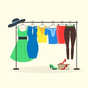 Kledingrekken met dameskleding op hangers