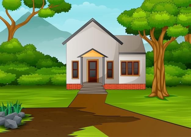 Klein huis in een prachtig landschap met groene tuin