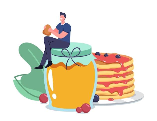 Klein mannelijk personage zittend op een enorme glazen pot met honing die verse, smakelijke pannenkoeken eet