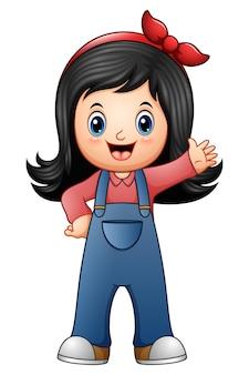 Klein meisje in blauwe overalls