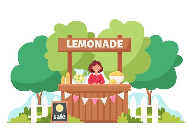 Klein meisje verkoopt koude limonade in limonadekraam zomertijd