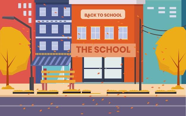 Klein schoolgebouw in het midden van de stad vol met bouwen