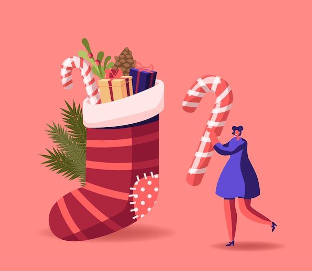 Klein vrouwelijk personage bereid je voor op de kerstviering