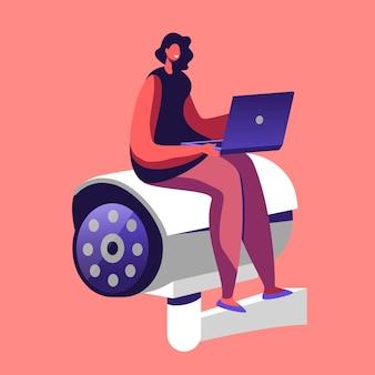 Klein vrouwelijk personage met laptop in handen zittend op enorme videocamera