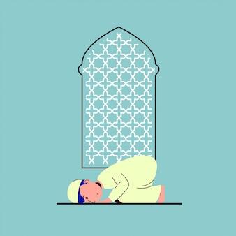 Kleine arabische moslimjongen die sujud beoefent