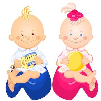 Kleine babyjongen en meisje met een rammelaar en bal in zijn hand glimlachend zittend op de potten