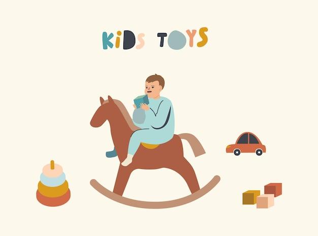 Kleine babyjongen zittend op een houten paard met kubus in de hand geïsoleerd op wit
