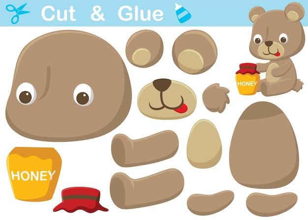 Kleine beer cartoon met honingpot. onderwijs papier spel voor kinderen. uitknippen en lijmen